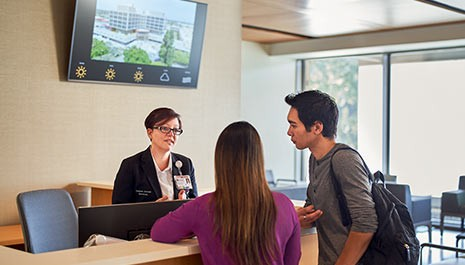 patients checking in the waiting reception of the new stanford hospital emergency department
