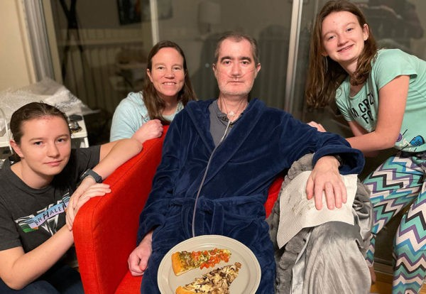 Rand Bresee and his wife, Michelle, center, treasure time with their daughters, Blakely, left, and Gretchen, as he recovers from surgery.